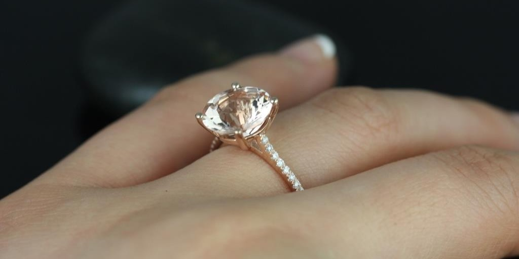 Rose gold diamond ring with a K color diamond
