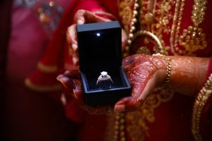 person holding a diamond ring